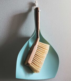 a broom and dustpan for cleaning your Panama City Beach storage unit